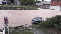 Death toll rises in West Virginia floods as rescue searches continue