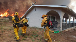 Watch as Flames Threaten Los Angeles-Area Homes