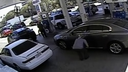 Caught on video: Thief snatches wallet out of car at gas station