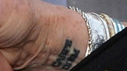 Judi Dench gets her first tattoo at 81! What does it say?