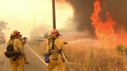 California wildfire: Body found as blaze nearly triples in size