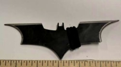 Holy Batarang! Man charged for throwing Batman's weapon at police car