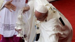 Pope Francis trips and falls, but still finishes Mass