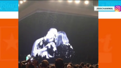 Adele gets smooch from a pooch during Los Angeles concert