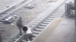 Watch: Transit Cop Pulls Man Off Track Seconds Before Train Rolls Through