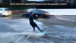 Watch SUV tow water skier through flooded streets of Moscow