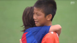 These soccer champs have true sportsmanship for consoling losing team
