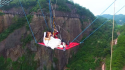 Watch Chinese Couple Wed While Dangling 590 ft Air