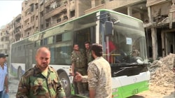 Residents and Rebels Leave Besieged Syrian Town