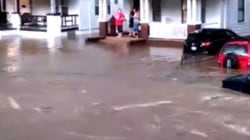 Flash Flooding Turns Suburban Street Into Raging River