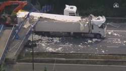 Watch Truck Crushed by Bridge on UK Motorway