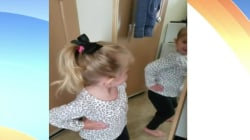 This tot says 'I'm cute' to her reflection, and you'll agree