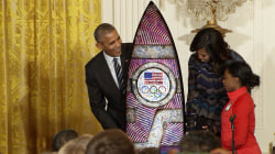 Obamas salute Olympians; Athletes Give President Surf Board