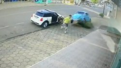 Caught on camera: Man leaps out of path of careening VW Beetle