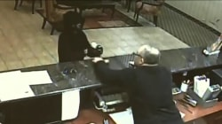 Video: Hotel clerk grabs suspect's gun, tackles would-be robber