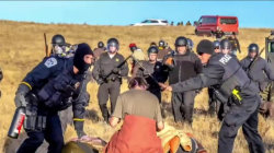 Police Clad in Riot Gear Move in On Dakota Access Pipeline Protesters