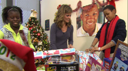 Deserving children open gifts from TODAY toy drive