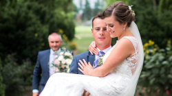 Groom carries bride down aisle weeks after accident