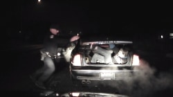 Caught on Camera: Armed Fugitive Jumps Out of Trunk During Police Stop