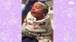 Adorable newborn has hair washed for the first time