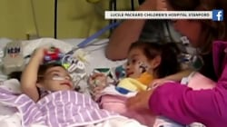 Formerly conjoined twins see each other for first time since separation surgery