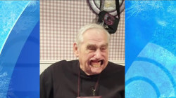 Watch this grandfather's dentures fall out as he plays 'Speak Out' game