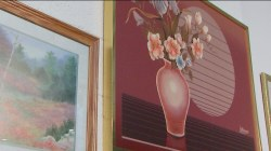 Super 8 puts old motel room paintings on display before giving them away