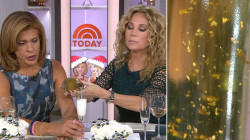 KLG and Hoda sample sparkling wine with 24-karat gold flakes