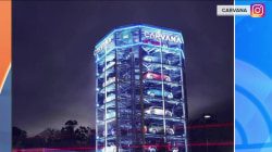 An 8-story car vending machine exists and it's pretty cool