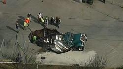 Sinkhole Swallows Excavation Truck