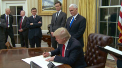Donald Trump signs first executive order before attending inaugural balls