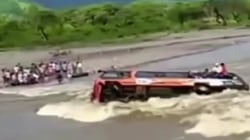 Caught on camera: Dramatic escape after bus overturns in raging, flooded river