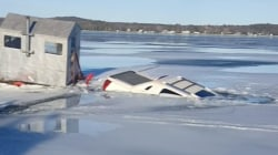 Truck Takes Polar Plunge Into Frozen Lake