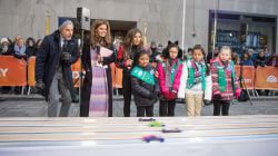 NASCAR's Danica Patrick helps Girl Scouts race cars on the plaza