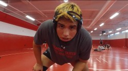 Once-homeless 'punk' finds his place on the wrestling mat