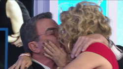Watch Kathie Lee sit in Tom Selleck's lap and give him a big smooch