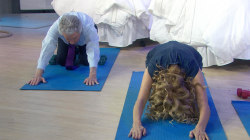 Watch KLG and Regis learn yoga moves to help them sleep better