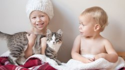 Parents teach children about compassion by adopting a kitten with leukemia