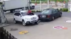 Woman Jumps on Hood to Stop Car Thief