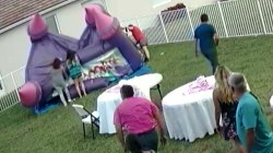 Man deflates bounce house with children outside, stirring outrage