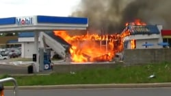 Gas station collapse caught on video: Trapped firefighter is rescued