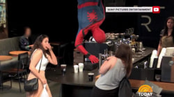 Watch Spider-Man startle Starbucks customers by popping out of ceiling
