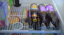 This clever trick makes stacking bottles or cans in your fridge easy peasy