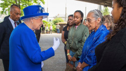 Queen Visits High-Rise Fire Homeless, Hears Stories of Survival