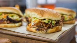Make this pulled pork sandwich 'low and slow,' with spicy mustard coleslaw