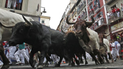 Bull Runners Tumble Onto Cobbled Streets on Fourth Day of Pamplona Festival