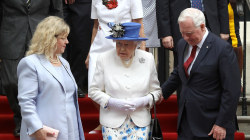 Queen Elizabeth Given a Helping Hand, But Did Royal Protocol Get Squeezed Out?