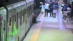 Woman dragged by train, caught on camera