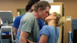 Injured man is able to stand, embrace and kiss his wife again