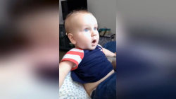 This baby can't believe his eyes after seeing his dad with no beard!